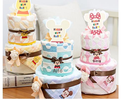 トレンドのやわらかいカラーのデイズニーKIDEAのおむつケーキ