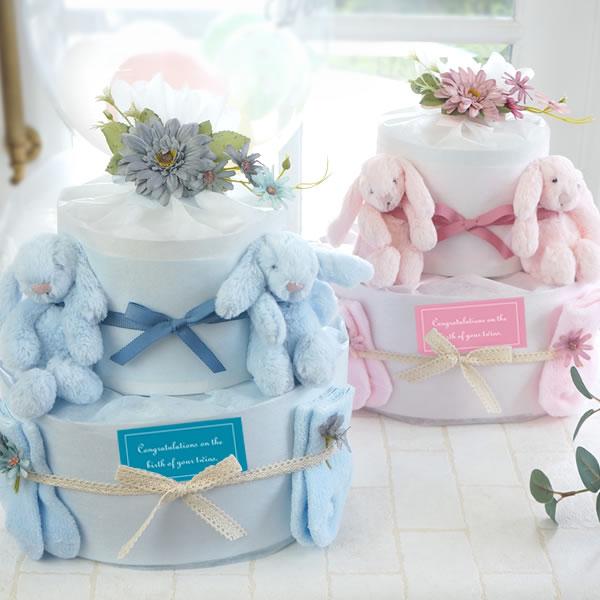 かわいい双子の赤ちゃんのためのジェリーキャットのおむつケーキ